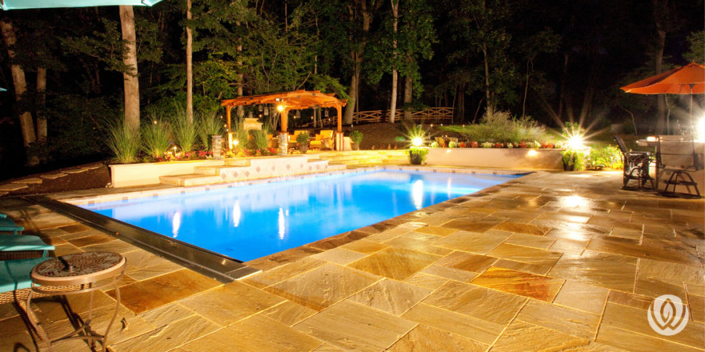 custom-concrete-pool-nighttime-oasis-backyard-pool