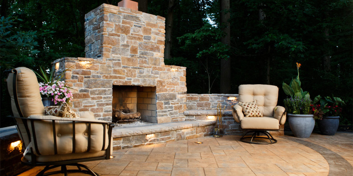 outdoor-living-space-with-chairs-and-fireplace