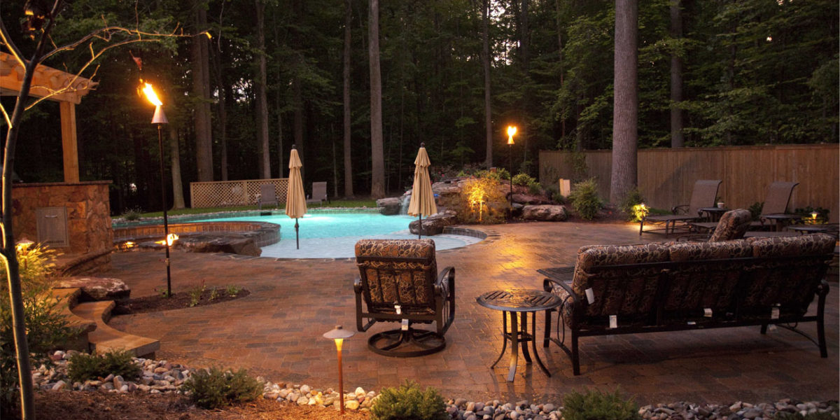 inground-pool-and-patio-at-night