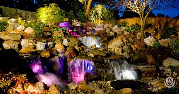 landscaping-on-a-slope-retaining-waterfall